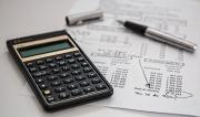 black-calculator-near-ballpoint-pen-on-white-printed-paper-53621.jpg