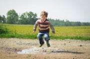 boy-jumping-near-grass-at-daytime-1104014.jpg